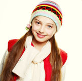 Little girl with clothes for the winter Stock Photos