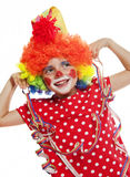 Little girl with clown costume Stock Images