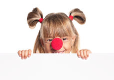 Little girl with clown nose Royalty Free Stock Images