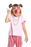 Little girl with clown nose. Little girl with red clown nose isolated on white background Royalty Free Stock Images
