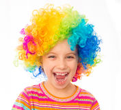 Little girl in clown wig. Smiling little girl in clown wig isolated on white background Stock Photos