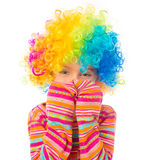 Little girl in clown wig. Cute little girl in clown wig isolated on white background Royalty Free Stock Photos