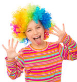 Little girl in clown wig. Smiling little girl shows tongue and hands in clown wig isolated on white background Stock Photos