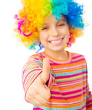 Little girl in clown wig. Smiling little girl in clown wig with thumbs up isolated on white background Royalty Free Stock Images
