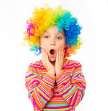 Little girl in clown wig Stock Images