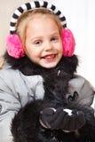 Little girl in coat Stock Photos