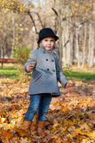 Little girl in a coat Stock Photos