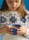 Little girl with cocoa drink in a bowl. In an winter day Royalty Free Stock Images