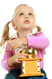 Little girl and a coffee grinder Royalty Free Stock Images