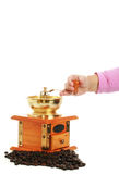 Little girl and a coffee grinder Royalty Free Stock Photography
