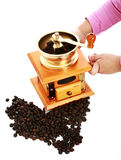 Little girl and a coffee grinder Stock Image