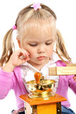 Little girl and a coffee grinder Royalty Free Stock Photos