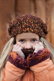 Little girl in the cold autumn Stock Photo