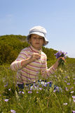 Little girl collect flowers Royalty Free Stock Images