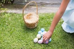 Little girl collecting easter eggs Royalty Free Stock Photo