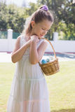 Little girl collecting easter eggs Royalty Free Stock Photography