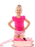 Little girl collects suitcase vacation rental Stock Photos