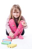 LIttle girl with color chalks Stock Images