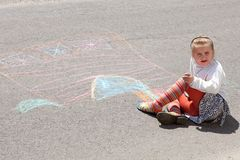 Little girl with color chalks Royalty Free Stock Photos