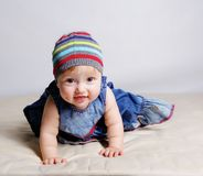 Little girl in color dresses Stock Photo