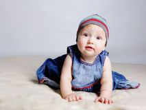 Little girl in color dresses Stock Photos