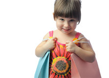 The little girl with color package Stock Photography