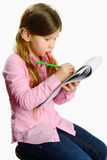 Little girl with color pencils Stock Photo