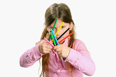 Little girl with color pencils Royalty Free Stock Images