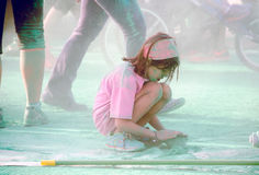 Little girl in color run race stock image