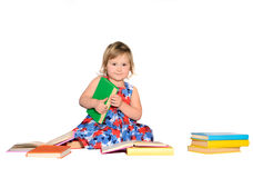 Little girl with colored books royalty free stock photography