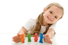 Little girl with colored clay figurines Stock Image