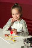 Little girl with colored clay figurines royalty free stock photos