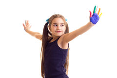 Little girl with colored hands Stock Image