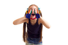 Little girl with colored hands Royalty Free Stock Photo