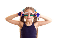 Little girl with colored hands Royalty Free Stock Photos