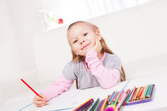 Little girl with colored pencils. Cute little girl drawing colored pencils at home Stock Photo