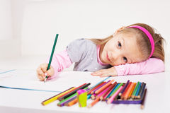 Little girl with colored pencils. Cute little girl drawing colored pencils at home Stock Images