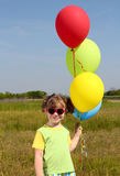 Little girl with colorful balloons Royalty Free Stock Photo