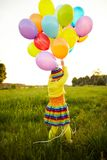 Little girl with colorful balloons Royalty Free Stock Image