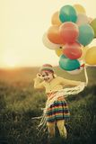 Little girl with colorful balloons Royalty Free Stock Photos