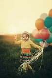 Little girl with colorful balloons Royalty Free Stock Photography