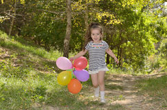 Little girl with colorful balloons Stock Photography