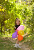 Little girl with colorful balloons Stock Photos