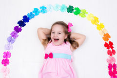 Little girl with colorful bow. Hair accessory Royalty Free Stock Photo