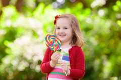 Little girl with colorful candy lollipop Royalty Free Stock Images