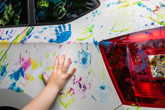 Little girl with colorful car Stock Photo