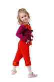 The little girl in colorful clothes Stock Photo