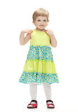 Little girl in colorful dress Stock Photos