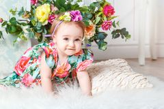Little girl in colorful dress with flowers stock photo