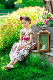 Little girl in colorful dress and flowers. Stock Image